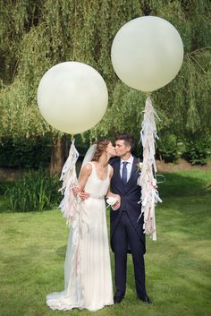 Giant fringed balloons + newlyweds = the perfect pairing!