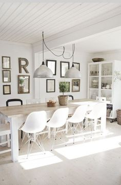 If we ever have to change our dining room table, I like a bleached look like this... Also the white glassed door kitchen cabinet... Nice feeling to this room, even though it may be a bit overwhelmingly white? Well, we would have wooden floors at least.