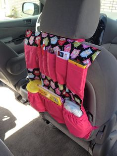 Avoid backseat disarray with an organizer complete with all of the essentials. | 15 Road Trip Hacks That'll Make For A Smooth Ride