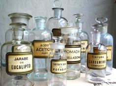Love this idea!! I have seen these alot, and wondered what to do with them...just displaying them is beautiful. Vintage Apothecary Bottles.