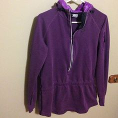 """NIKE Hoodie Sweatshirt Jacket Purple Nike jacket that zips half way up. The good has a cool """"windbreaker"""" like material in it and the sides have a black detail along them. The zipper has reflective border and the jacket is fitted towards the middle. The tag reads medium, but I believe it fits more of a small. Nike Tops"""