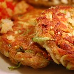 "Zucchini ""Crab"" Cakes (tastes like crab cakes, but with no crab).Make sure you squeeze out the excess water from the zucchini after grating it or they'll be soggy.  I would bake instead of fry these. I would also serve it with some sort of sauce, maybe a homemade tarter or a garlic aioli?"