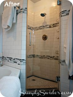 custom shower stall with subway tile and glass mosaic