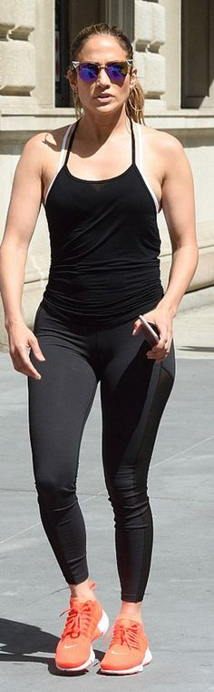 Who made Jennifer Lopez's purple cat sunglasses, black leggings, tank top, and red sneakers?
