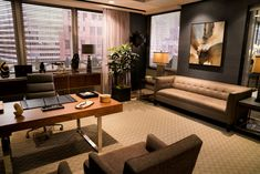 On the set of The Good Fight (CBS's new spinoff of The Good Wife), Robert's law office showcases a Noelle Giddings painting beneath the Mitchell Gold + Bob Williams modern tufted shelter-style Kennedy sofa. And in front of the desk, two of our Cameron chairs. Our website: www.mgbwhome.com