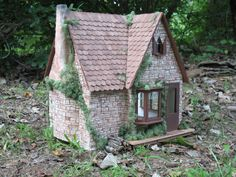Handcrafted rustic cottage dollhouse