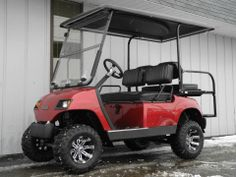 This 2000 Yamaha G16 custom street-ready gas golf car has a freshly-painted Garnet Red body, 4-inch lift kit, new black seat covers, extended hard top with built-in enclosure tracks, premium lights, folding windshield, horn, 5-panel rear view mirror, license plate bracket, rear flip seat, carbon fiber dash kit with dual locking glove boxes, custom steering wheel, and 20-inch tires on 10-inch aluminum wheels for $4790.   #Yamaha #G16 #customgolfcar #liftedgolfcar #red #gasgolfcar #PES…