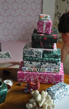 man! tower of floral wrapping papers!