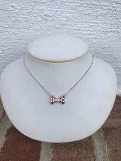 Show off your love for your favorite Disney mouse with this adorable Minnie Mouse Bowtie Necklace from Chamilia. A beautiful sterling silver Minnie Mouse Bow with red Swarovski crystals split chain. A must have for that Disney fan in your life! Minnie Mouse Bow, Disney Mouse, Chamilia Jewelry, Disney Charms, Little Baby Girl, Disney Jewelry, Sterling Silver Necklaces, Swarovski Crystals, Pendant Necklace