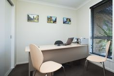 A home office at the front of the home. Doors can be closed to ensure clients come through to the office and leave the rest of the home private for the benefit of all.