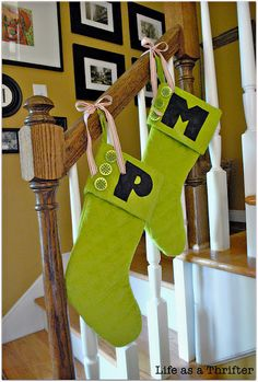 Holiday christmas on pinterest burlap stockings outdoor for Hang stockings staircase