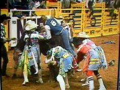 2010 Las Vegas, NV- Tuff Hedeman gets hung up and Rob Smits breaks his own neck trying to get Tuff off the bull.