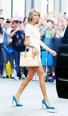 Taylor Swift in a little white romper by Rachel Zoe