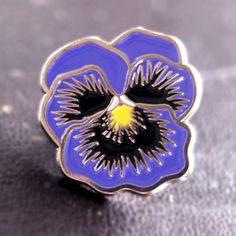 "For all the horticulturalists and proud pansies out there.    Soft enamel, 3/4"", black rubber clasp"