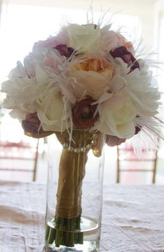 add some feathers and bling to your bouquet
