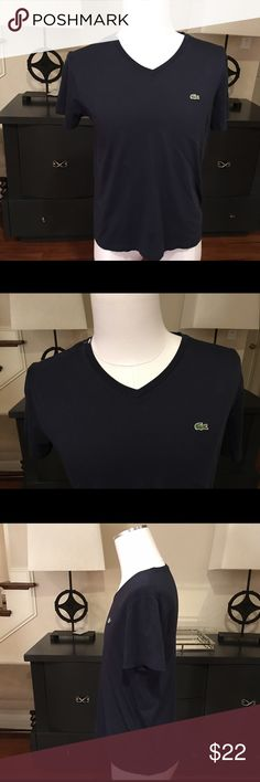 Lacoste Men's Navy V Neck Tee Looks practically brand new. Not faded at all is a Men's Navy V Neck Lacoste Tee. Crafted on ultra soft cotton, this solid v Neck Tee from Lacoste is the perfect combo of casual comfort and classic style. Lacoste croc at chest Lacoste Shirts Tees - Short Sleeve