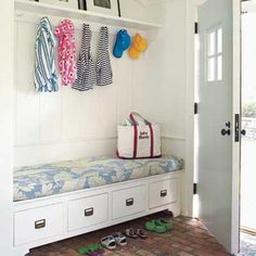 A brick-floored mudroom serves as a buffer between the house and garden, with a boot bench that doubles as storage for flip-flops. | Photo: Tria Giovan | thisoldhouse.com