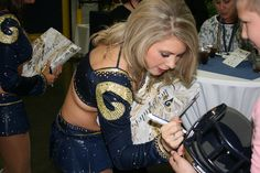 The St. Louis Rams Cheerleaders mingled with the crowd, signing autographs and taking pictures. Taste of the NFL by St. Louis Area Foodbank, via Flickr @St. Louis Rams @Taste of the NFL
