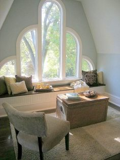 If you've got a really awkward shaped window, don't try to disguise it.  Celebrate it's beauty and make a statement of it