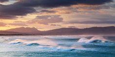 landscape photograph of waves in extreme wind in the kleinmond bay