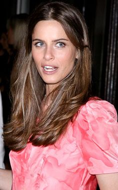 Natural brown with lighter highlights going through hair to make more voluminous.