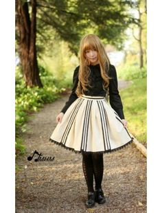 Elegant black lolita blouse for girls, peter pan collar with ruffle trim, long sleeves with buttons and single line button closure down. It is tailored by quality cotton that is very comfortable to wear.