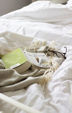 There's something instantly calming about curling in bed with a good book. Photo: Cider With Rosie
