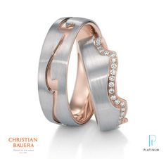 Christian Bauer platinum and 18k rose gold wedding band.