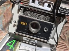 1970s Blue Gray Polaroid 420 Automatic Land Camera With Flash, Manuals, And Strap