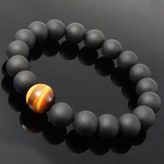 Handmade elastic band bracelet with matte black onyx and tiger eye gemstone…