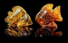 A Collection of Carved Amber Fish,, Oligocene, Santo Domingo, Dominican Republic,, consisting of two whimsical fish carvings of - Price Estimate: $800 - $1200