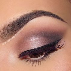 Urban Decay Naked 3's Dust on the lid and inner corner, Buzz on the outer lid, Blackheart on the crease and lower lash line, Nooner and Limit for blending and Strange for the brow bone for a pink/plum smoky eye for brown eyes