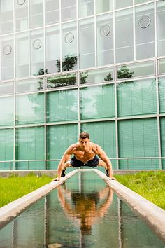Personal trainer doing outdoor training in urban place, Munich, Bavaria, Germany