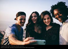 https://www.photocase.com/photos/1877786-multi-ethnic-group-of-young-adult-friends-taking-selfie-woman-man-relaxation-photocase-stock-photo-large.jpeg