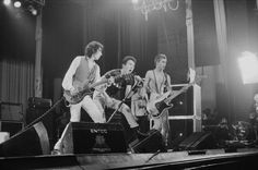 The Clash performing at the Apollo Manchester 2nd July 1978 Left to right Mick Jones Joe Strummer and Paul Simonon.