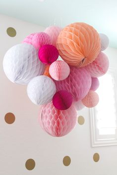 Honeycomb Balls in Nursery - a playful way to add a pop of color that baby will love to look at!