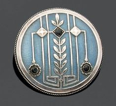 HEINRICH LEVINGER BUTTON in blue enamelled silver with decoration of geometric threads, laurel frieze, flowers and black stones