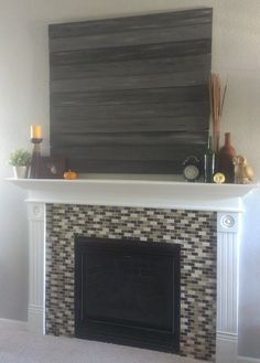 A few weeks ago when I decorated the mantel for fall, I shared this picture of my embarrassingly bad job of removing some tile from our f...