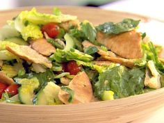 Ellie's homemade crouton variation tops her Herb Toasted Pita Salad, featuring fresh herbs and a lemon-oil dressing.