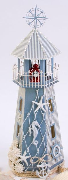 I couldn't resist making a lighthouse box with nautical elements to celebrate the stunning Shoreline Treasure collection. The top lifts off so that gifts can be placed inside. A small red lan…