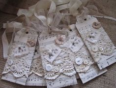 these music tags could have kingdom songs and tied to bridesmaid bouquets or gift tags with a special song on bridesmaids gifts
