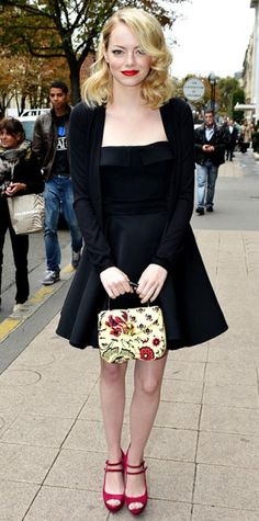 Look of the Day › October 4, 2012 WHAT SHE WORE At Paris Fashion Week, Stone headed to the Miu Miu runway show in a strapless LBD that she styled with a black cardigan, floral tote and ankle-strap peep-toes.