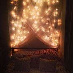 Created my ideal canopy bed, with simple fairy lights, voile and push pins and it makes me feel like a complete princess!