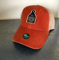 Show off your support for local, small family farms by sporting one of our trucker hats! Made with 100% cotton twill it looks weathered and rugged yet is super comfortable and durable...just ask our farmers who wear them! The mesh back is breathable, adjustable snap closure ensures a great fit, and a Kelly green undervisor gives it an old-school look. Showcasing our farm logo front and center this hat will be your go to hat when youre in the need for something stylish yet comfortable…