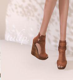 Tulip http://maps.secondlife.com/secondlife/Shoetopia%201/72/51/502