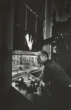 W. Eugene Smith at 4th floor window of 821 Sixth Avenue (ca. 1957)  Photograph by W. Eugene Smith