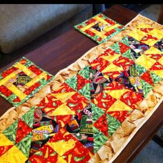 Quilted table runner for Christmas Eve Taco Night. Matching pot holders.