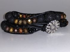 "Double-Wrap on 1.5 mm Black Leather Bracelet    Czech Glass & Black Lava Beads    Metal Flower Button    Adjustable length - 14"" or 15"" 
