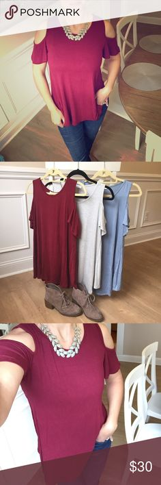 Cold Shoulder Top Ultra-super soft! Stretch, jersey feel, shoulder cut outs. Flowy & flattering, perfect for spring with jeans, leggings, or shorts! Rayon/Spandex blend (grey has Poly also.) Available in Wine, Baby Blue, or Grey. Tops