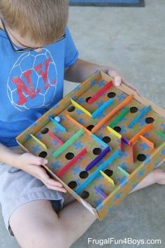 How to Make a Cardboard Box Marble Labyrinth Game - Frugal Fun For Boys Engineering STEM activity for kids - Build a cardboard box marble labyrinth! Get the marble through the course without it dropping into the holes. Kids Crafts, Diy And Crafts, Craft Projects, Arts And Crafts, Wood Crafts, Recycled Crafts For Kids, Crafts For Children, Recycling Projects For Kids, Popsicle Stick Crafts For Kids